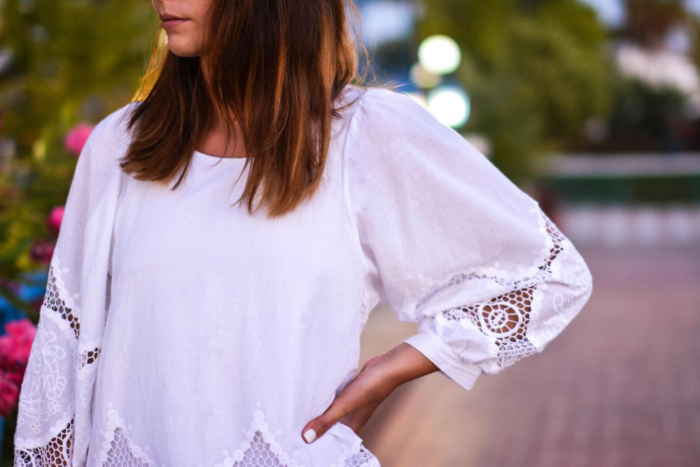 EJSTYLE - Emma Hill wears white puff sleeve cut out top dress with embroidery detail