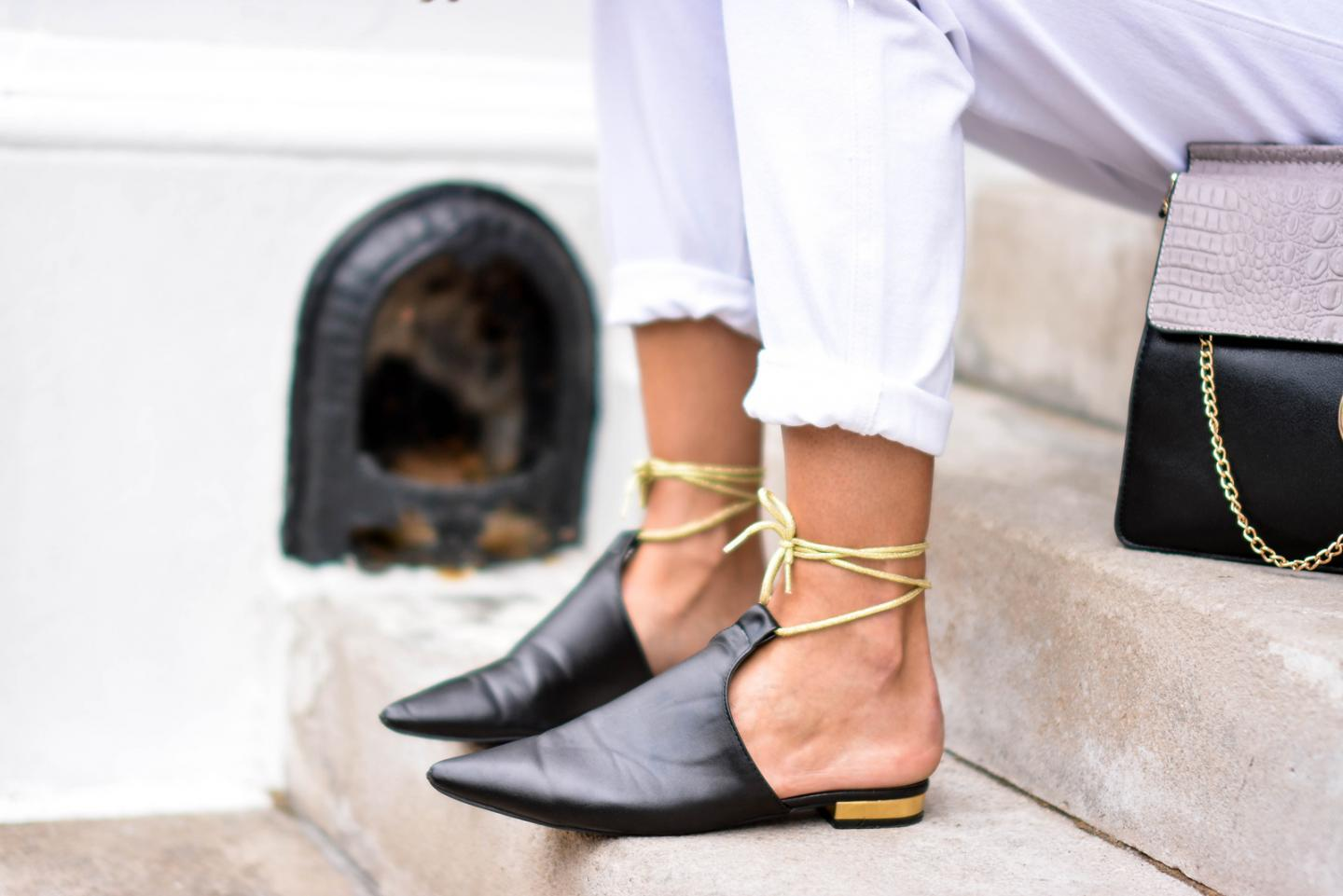 EJSTYLE - Emma Hill wears white ripped boyfriend jeans, black gold ankle tie chanel style mules flats
