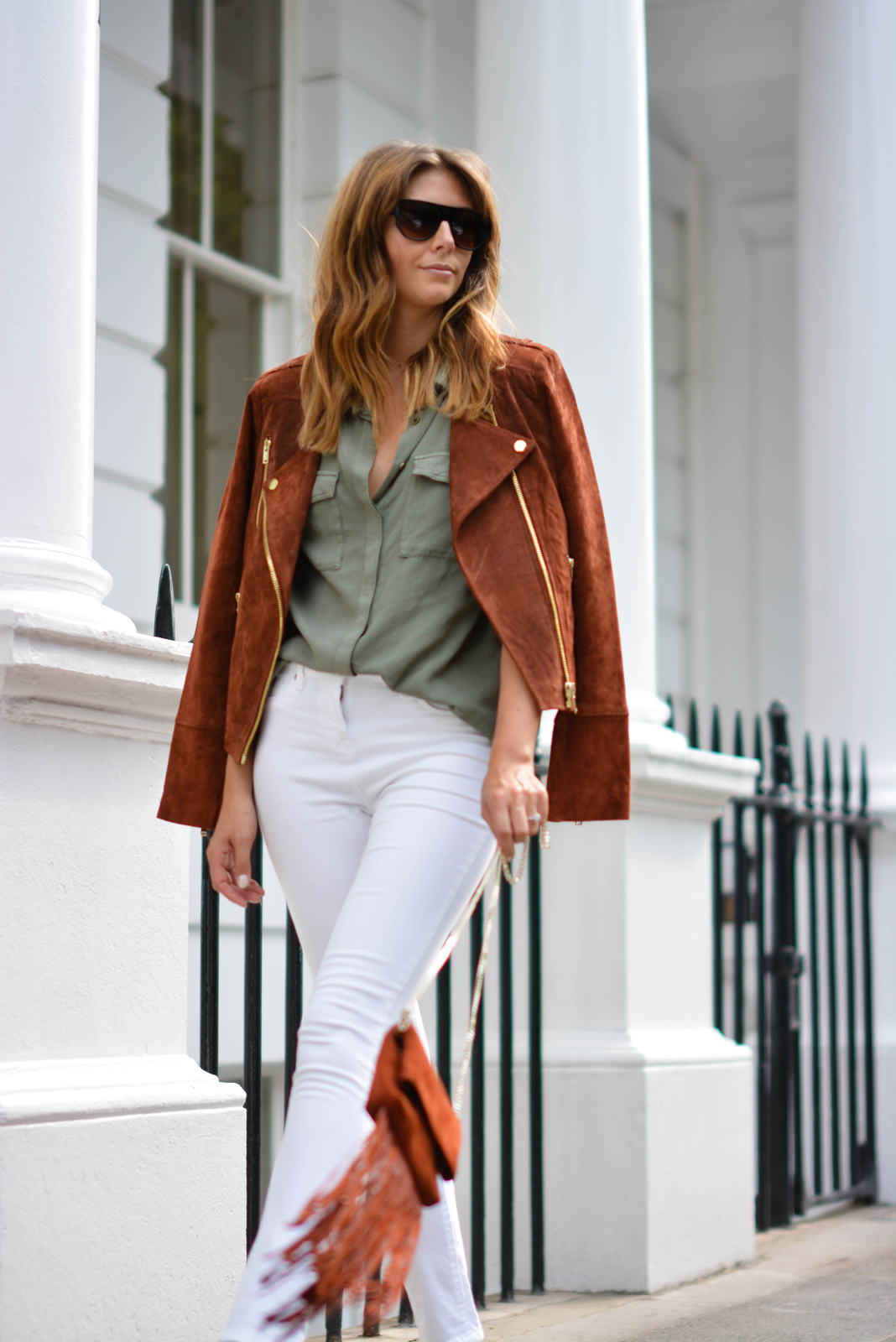 EJSTYLE - Rust suede biker jacket, Khaki shirt, white jeans, rust suede tassel fringe cross body bag, flat top square sunglasses, street style london