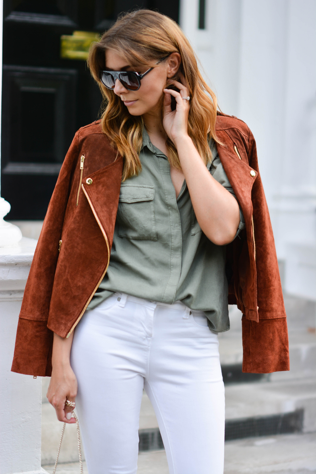EJSTYLE - Rust suede biker jacket, Khaki shirt, white jeans, rust suede tassel fringe cross body bag, flat top square sunglasses