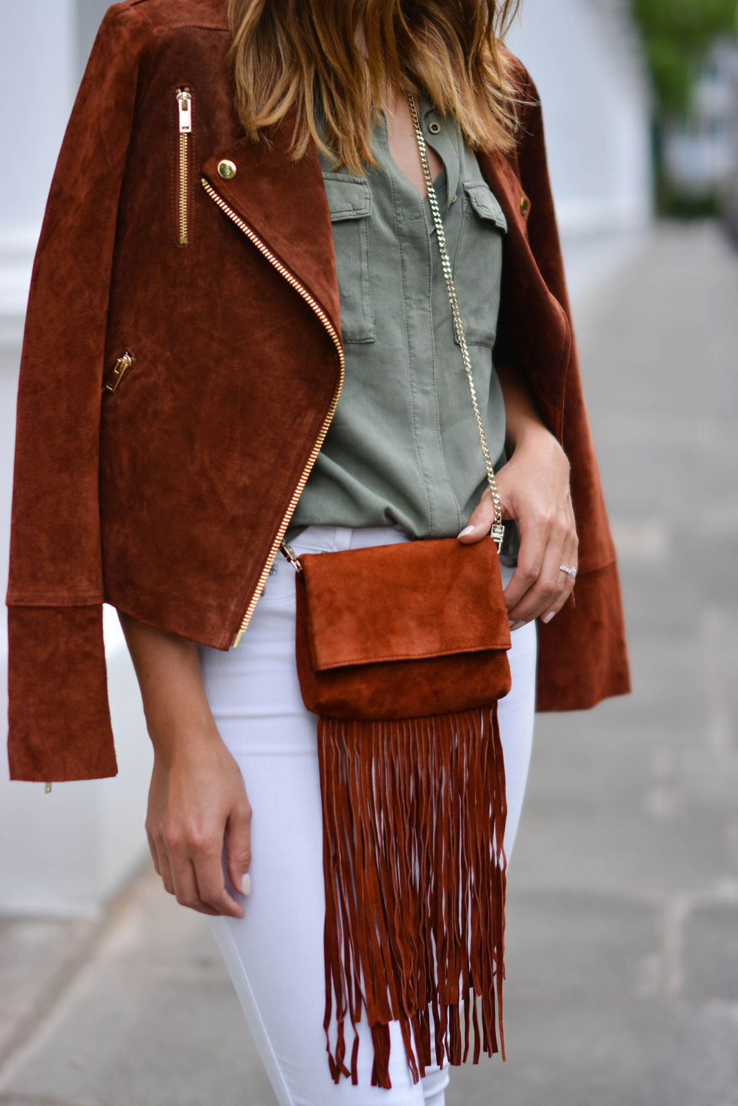 EJSTYLE - Rust suede biker jacket, Khaki shirt, white jeans, rust suede tassel fringe cross body bag