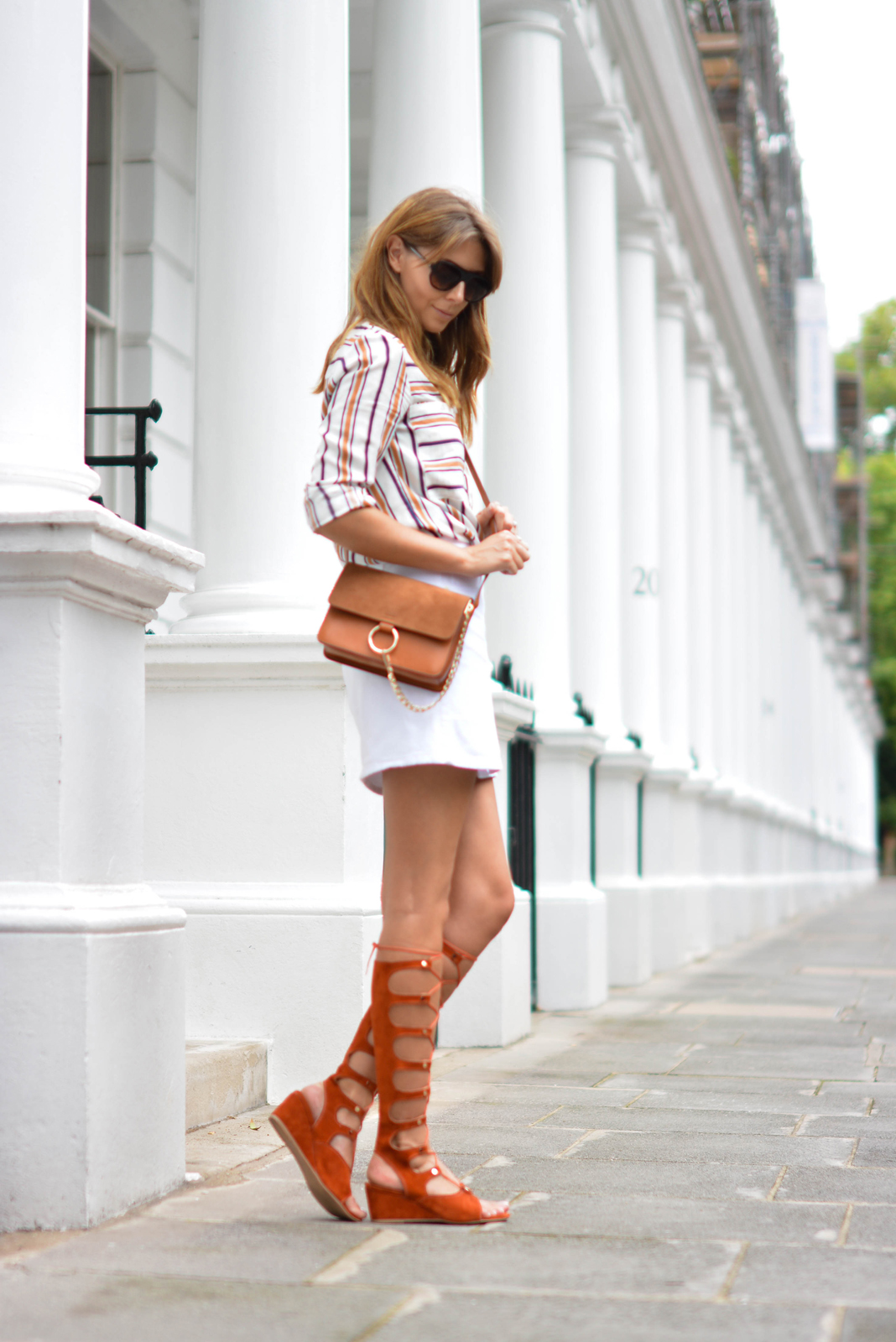 EJSTYLE wears Chloe style Tan lace up gladiator wedge sandals, White button up denim mini skirt, retro stripe shirt, Tan suede leather chloe style Faye bag, summer outfit, OOTD