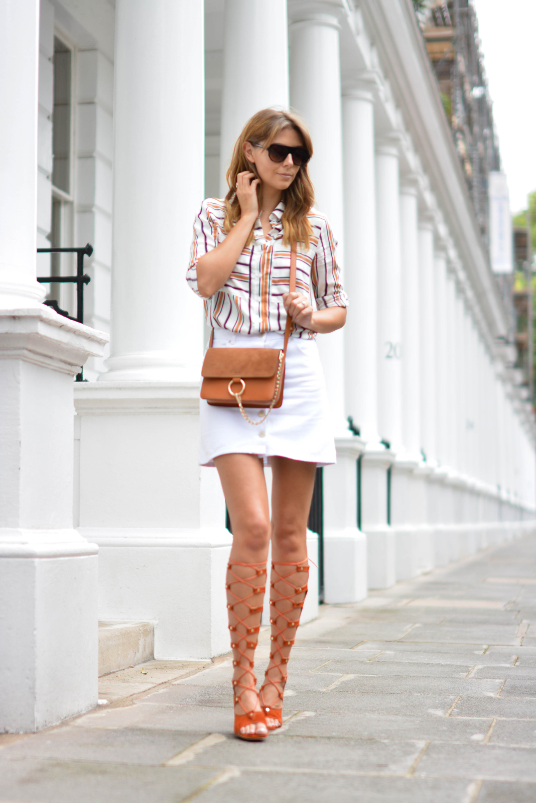 EJSTYLE wears Chloe style Tan lace up gladiator wedge sandals, White button up denim mini skirt, retro stripe shirt, Tan suede leather chloe style Faye bag, summer outfit