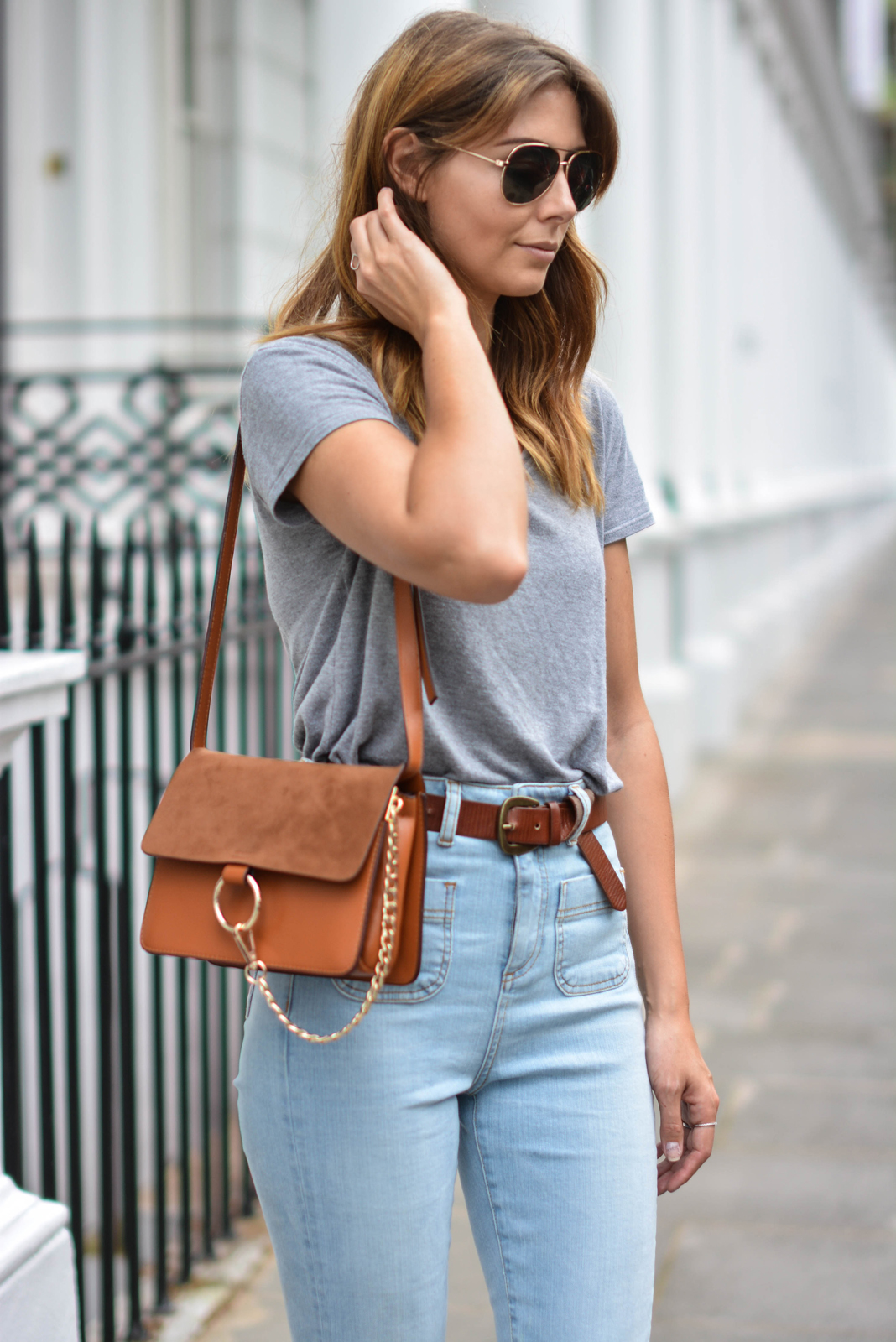 EJSTYLE wears Grey basic v neck t shirt, aviator sungasses,Tan suede leather chloe style Faye bag by Jessica Buurman, High waisted flare jeans, tan knot belt OOTD