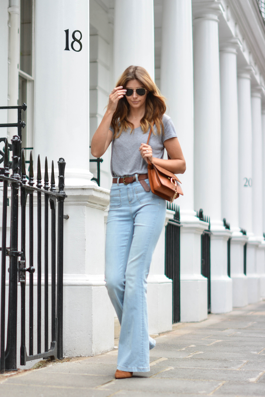 EJSTYLE wears Grey basic v neck t shirt, aviator sungasses,Tan suede leather chloe style Faye bag by Jessica Buurman, High waisted flare jeans, tan knot belt, tan suede heels OOTD