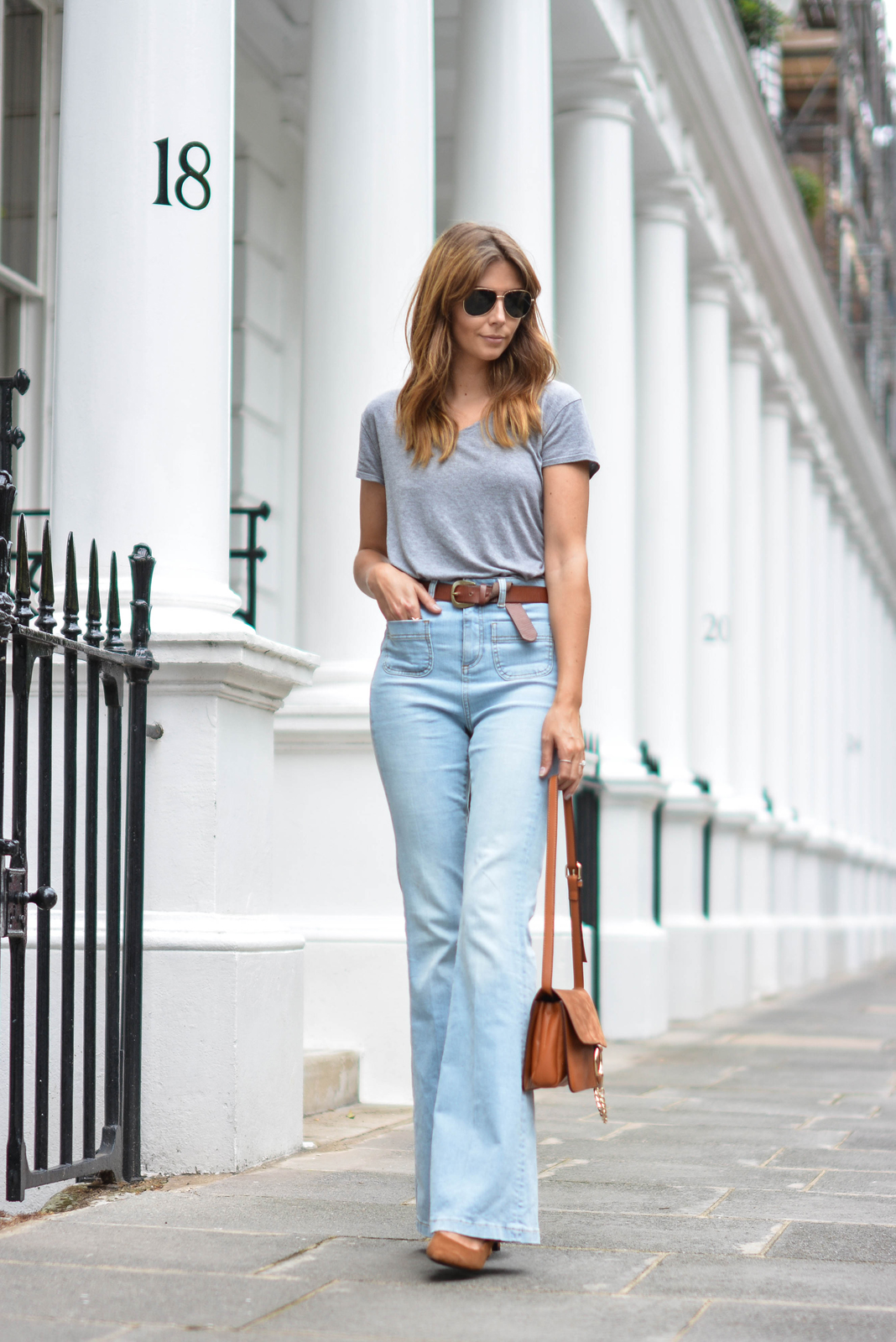 EJSTYLE wears Grey basic v neck t shirt, aviator sungasses,Tan suede leather chloe style Faye bag by Jessica Buurman, High waisted flare jeans, tan knot belt, tan suede heels