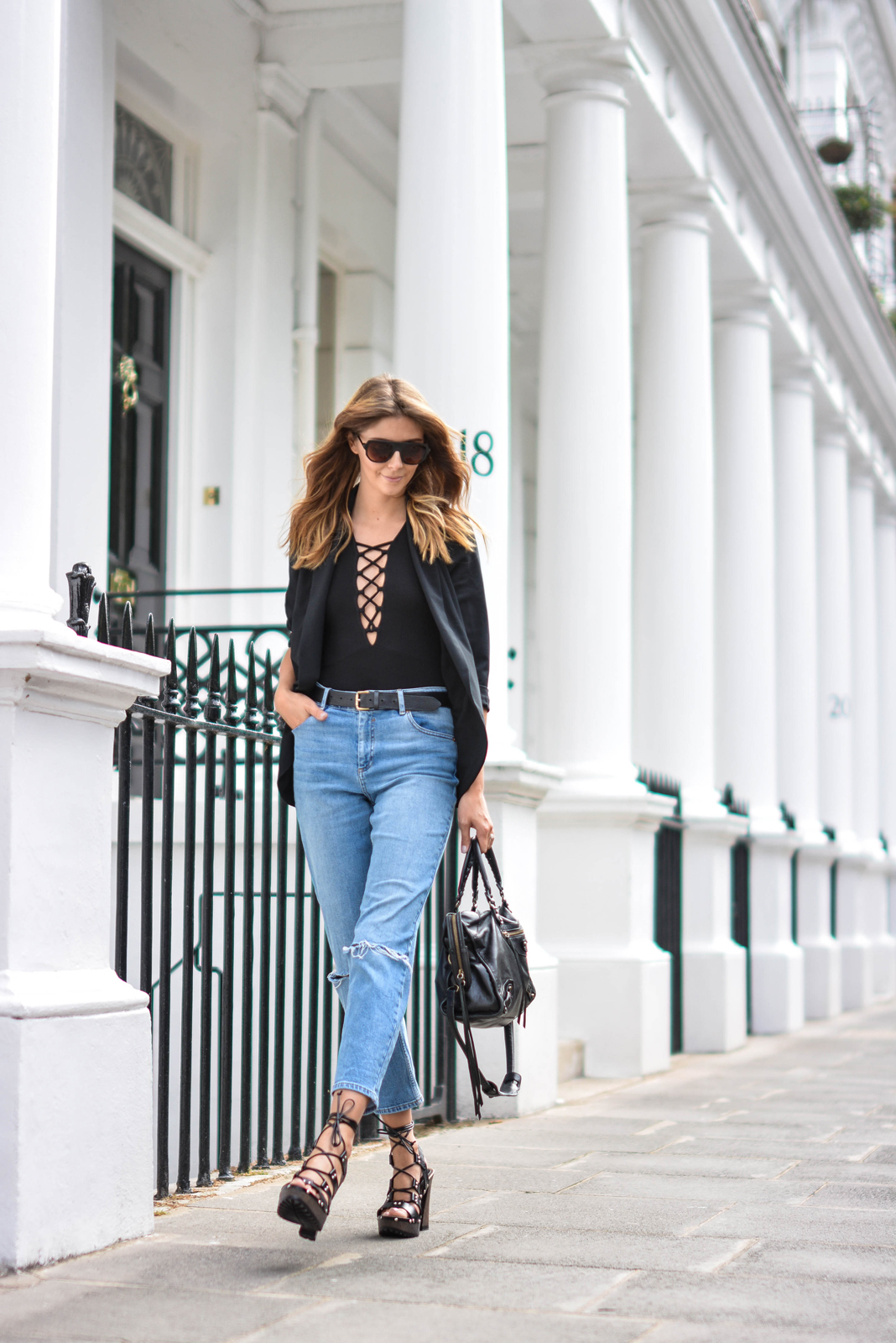 EJSTYLE wears Lace up black top, Black blazer, girlfreind jeans, black belt, Flat top square sunglasses, Balenciaga city bag black, asos turn back time wooden platform lace up sandals heels
