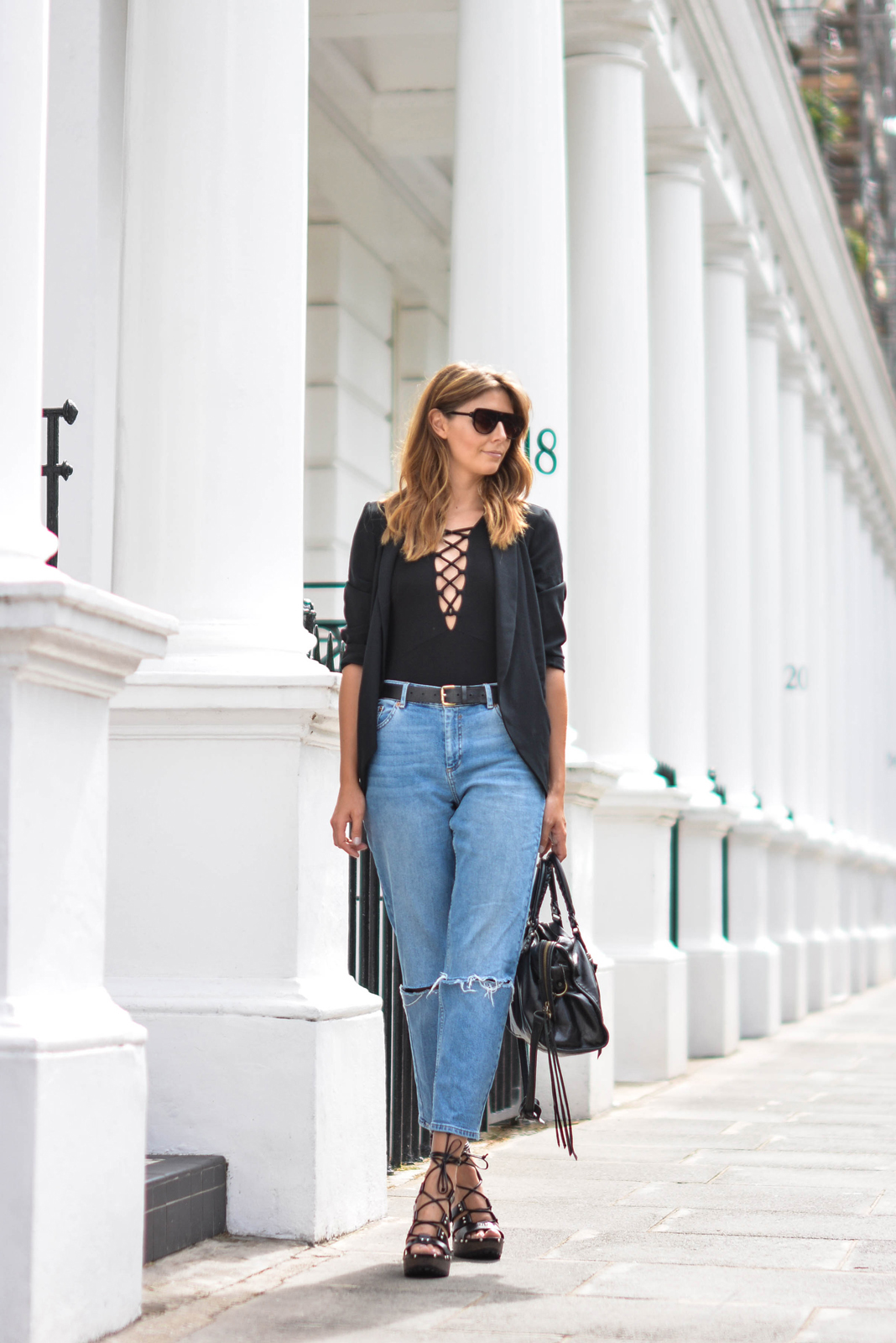 EJSTYLE wears Lace up black top, Black blazer, girlfreind jeans, black belt, Flat top square sunglasses, Balenciaga city bag black, asos turn back time wooden platform lace up sandals heels,