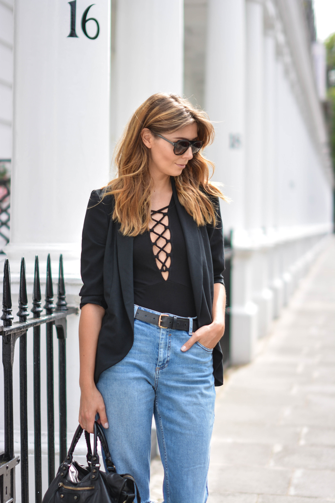 EJSTYLE wears Lace up black top, Black blazer, girlfreind jeans, black belt, Flat top square sunglasses, Balenciaga city bag black