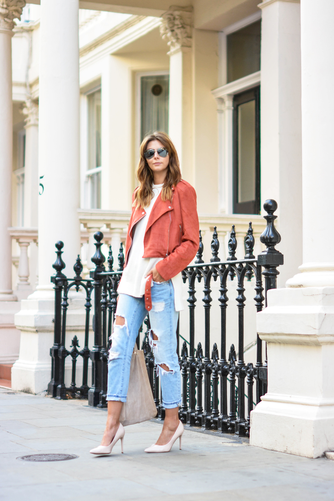 EJSTYLE wears Missguided rust faux suede biker jacket, sleevless knitted vest jumper, ripped light wash boyfriend jeans, nude patent heels pumps, nude suede bag, London street style