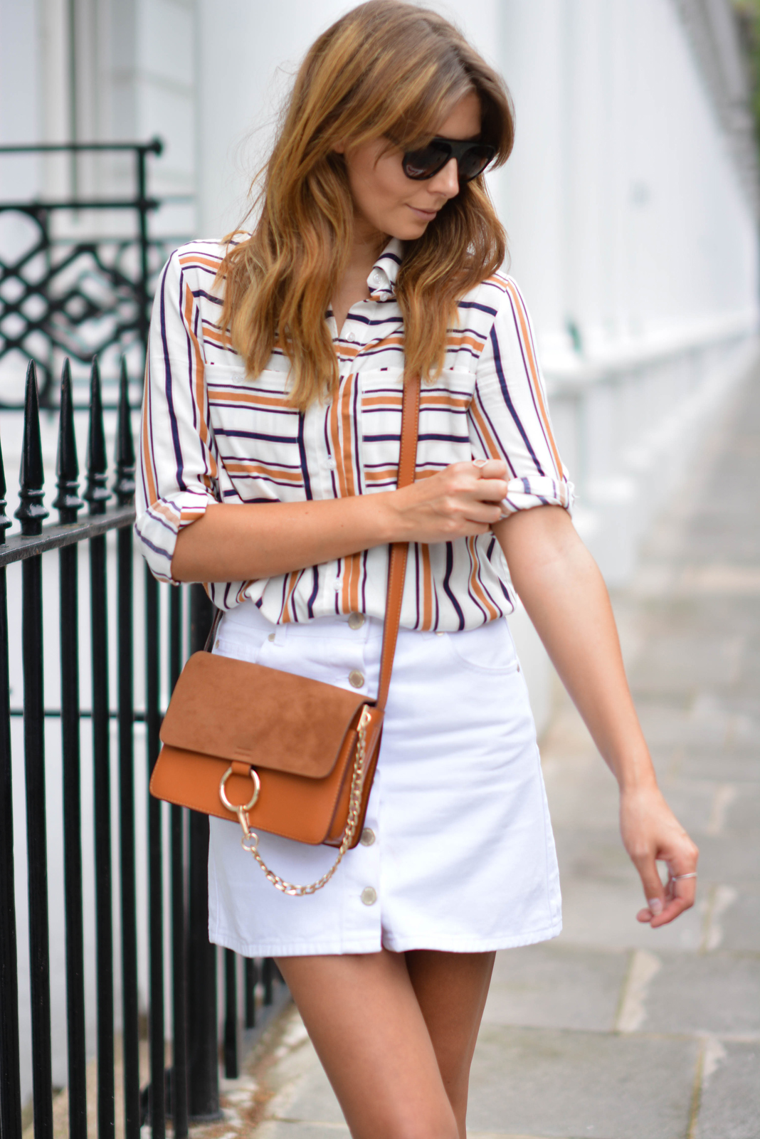 EJSTYLE wears White button up denim mini skirt, retro stripe shirt, Tan suede leather chloe style Faye bag, flat top sunglasses