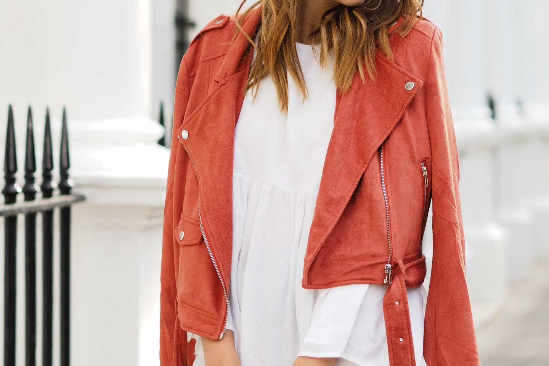 EJSTYLE wears rust suede biker jacket, bell sleeve open back white floaty top,