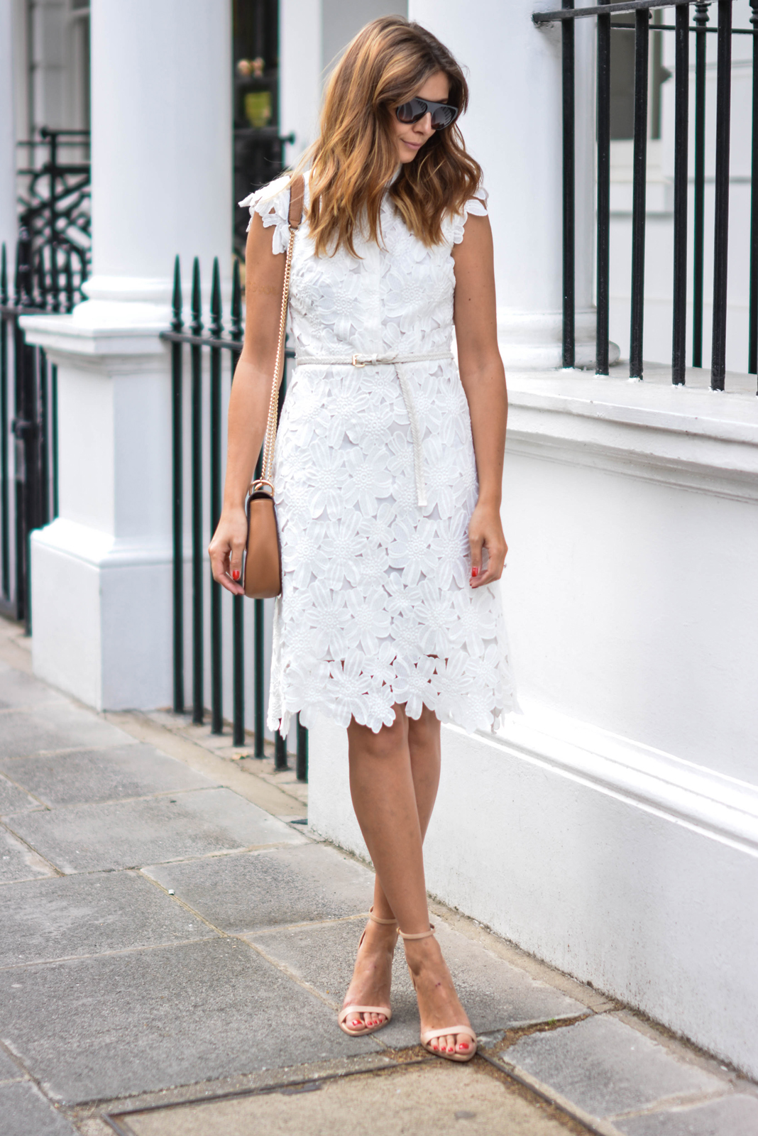 EJSTYLE wears white lace dress, nude barely there sandals, tan shoulder bag, wedding guest outfit, bridal shower outfit