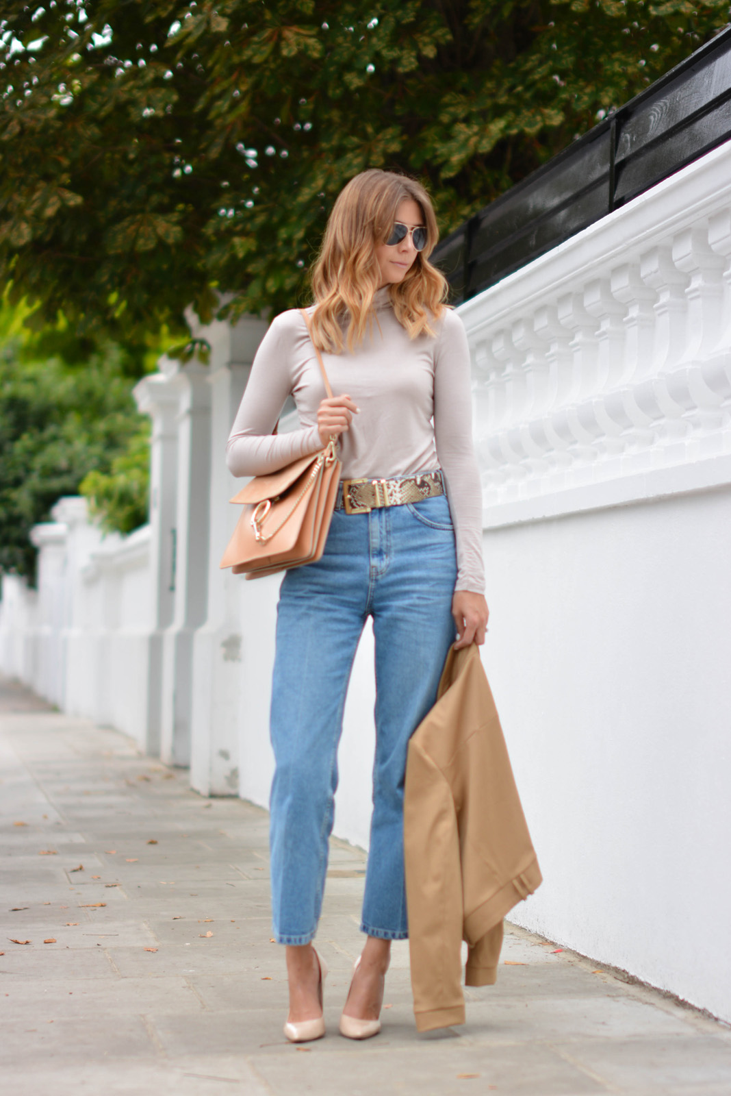 EJSTYLE wears Chloe Faye bag medium in Misty Beige, snakeskin belt, taupe roll neck top, light wash wide leg Topshop jeans, camel jacket, nude pointed heels, aviator sunglasses