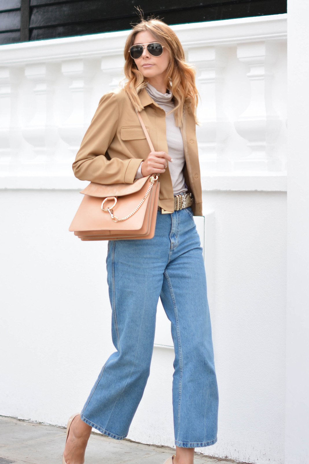 EJSTYLE wears Chloe Faye bag medium in Misty Beige, snakeskin belt, taupe roll neck top, light wash wide leg Topshop jeans, cropped camel jacket, aviator sunglasses