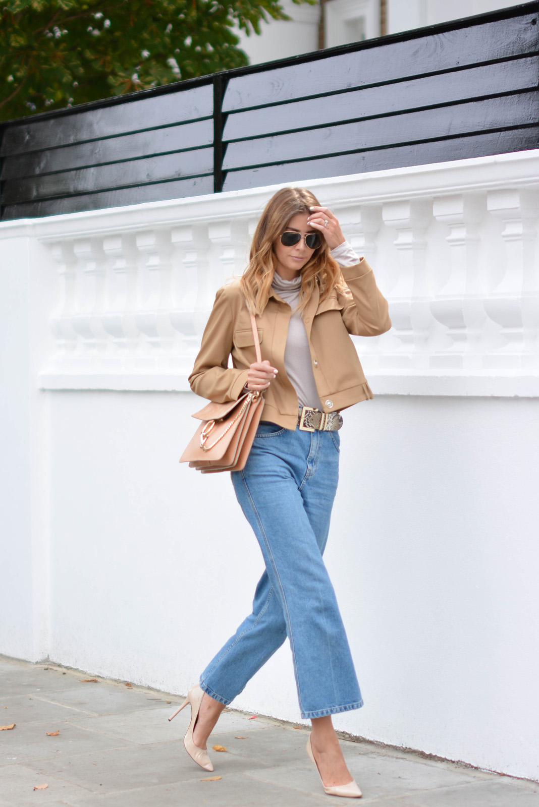 EJSTYLE wears Chloe Faye bag medium in Misty Beige, snakeskin belt, taupe roll neck top, light wash wide leg Topshop jeans, cropped camel jacket, nude pointed heels, aviator sunglasses