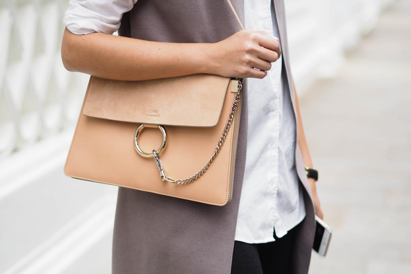 EJSTYLE wears Misty Beige Chloe Faye bag, taupe sleeveless coat, white shirt