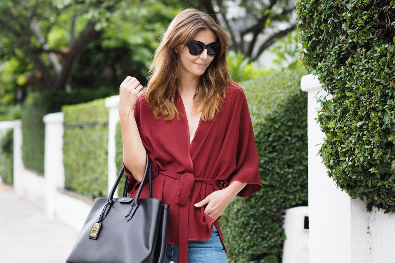 EJSTYLE wears Ralph Lauren black leather city tote bag, dark red wrap jacket