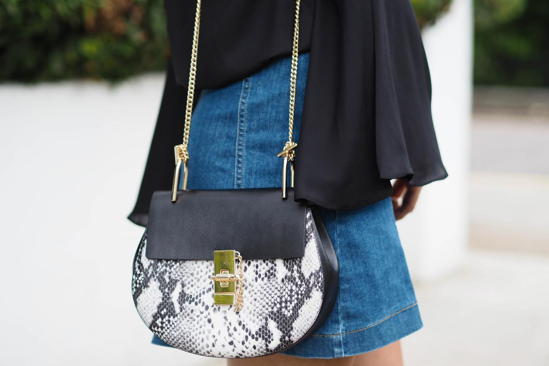 EJSTYLE wears bell sleeve black shirt, button down denim skirt, black grey snakeskin chloe drew dupe bag, 70s fashion