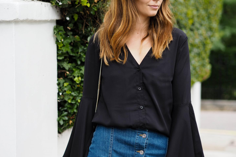 EJSTYLE wears bell sleeve black shirt, button up denim skirt