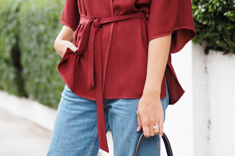 EJSTYLE wears dark red wrap jacket, topshop wide leg jeans