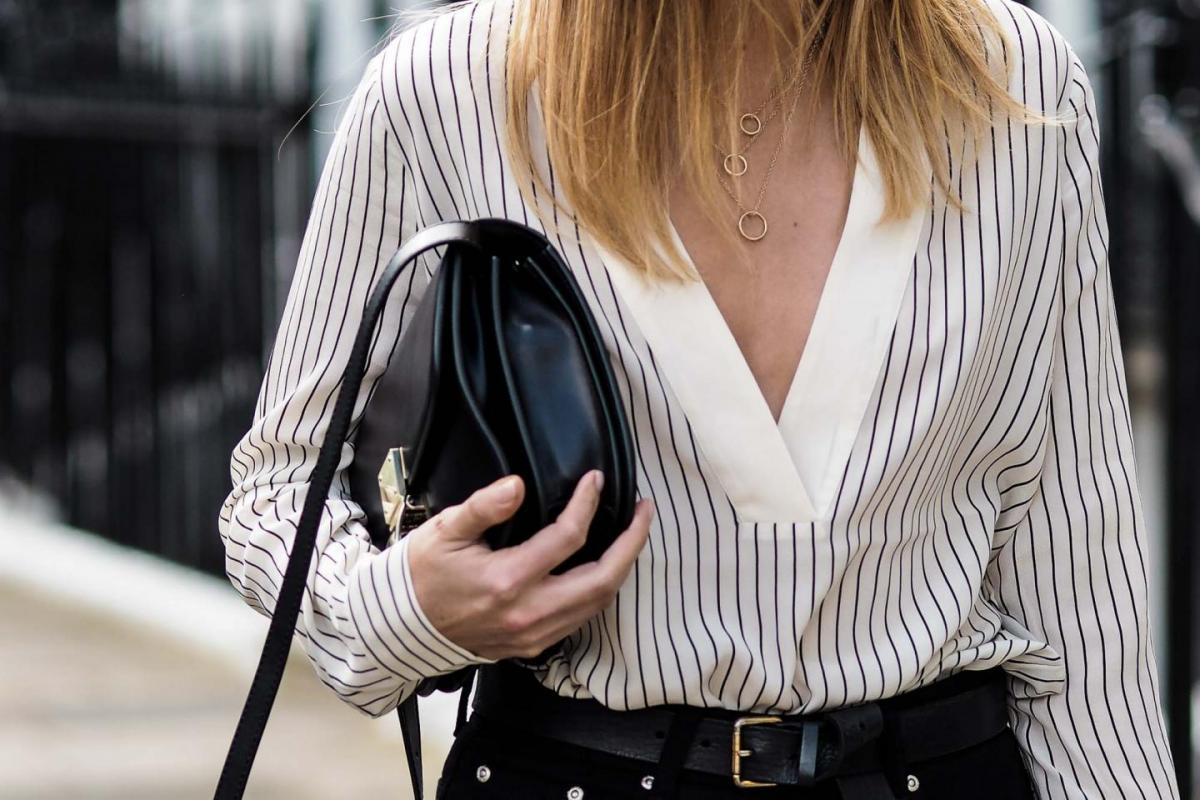Pinstripe low cut silk blouse, celine box bag, high waisted black jeans, gold layered necklaces