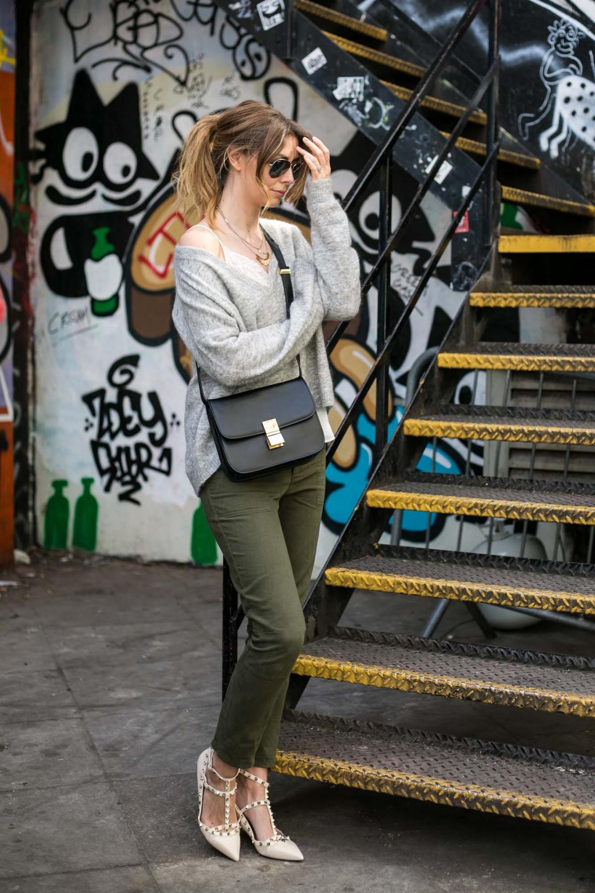 cream valentino rockstud flats, khaki trousers, grey v neck jumper, celine box bag, lcae cami
