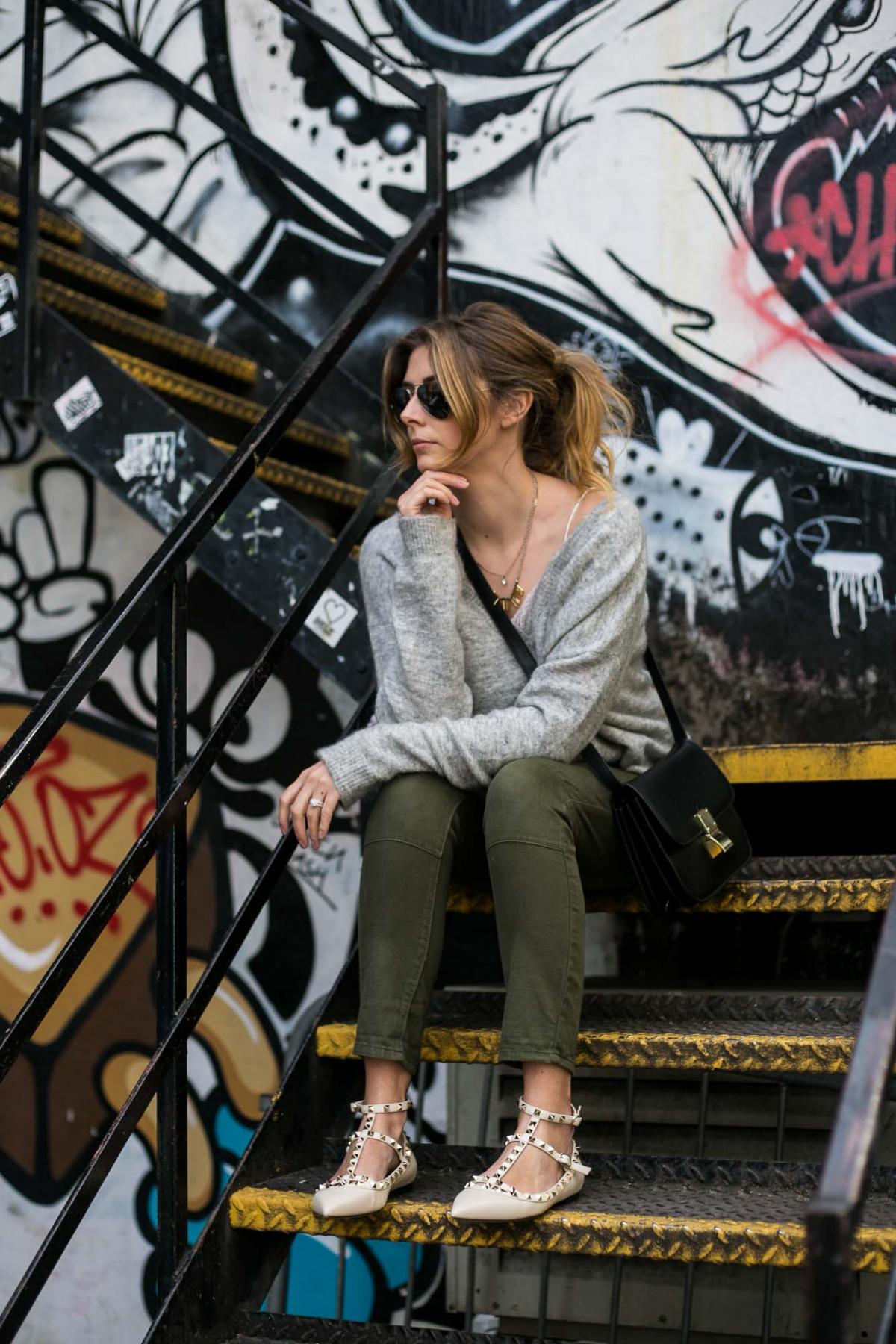 cream valentino rockstud flats, khaki trousers, grey v neck jumper, celine box bag, london street style