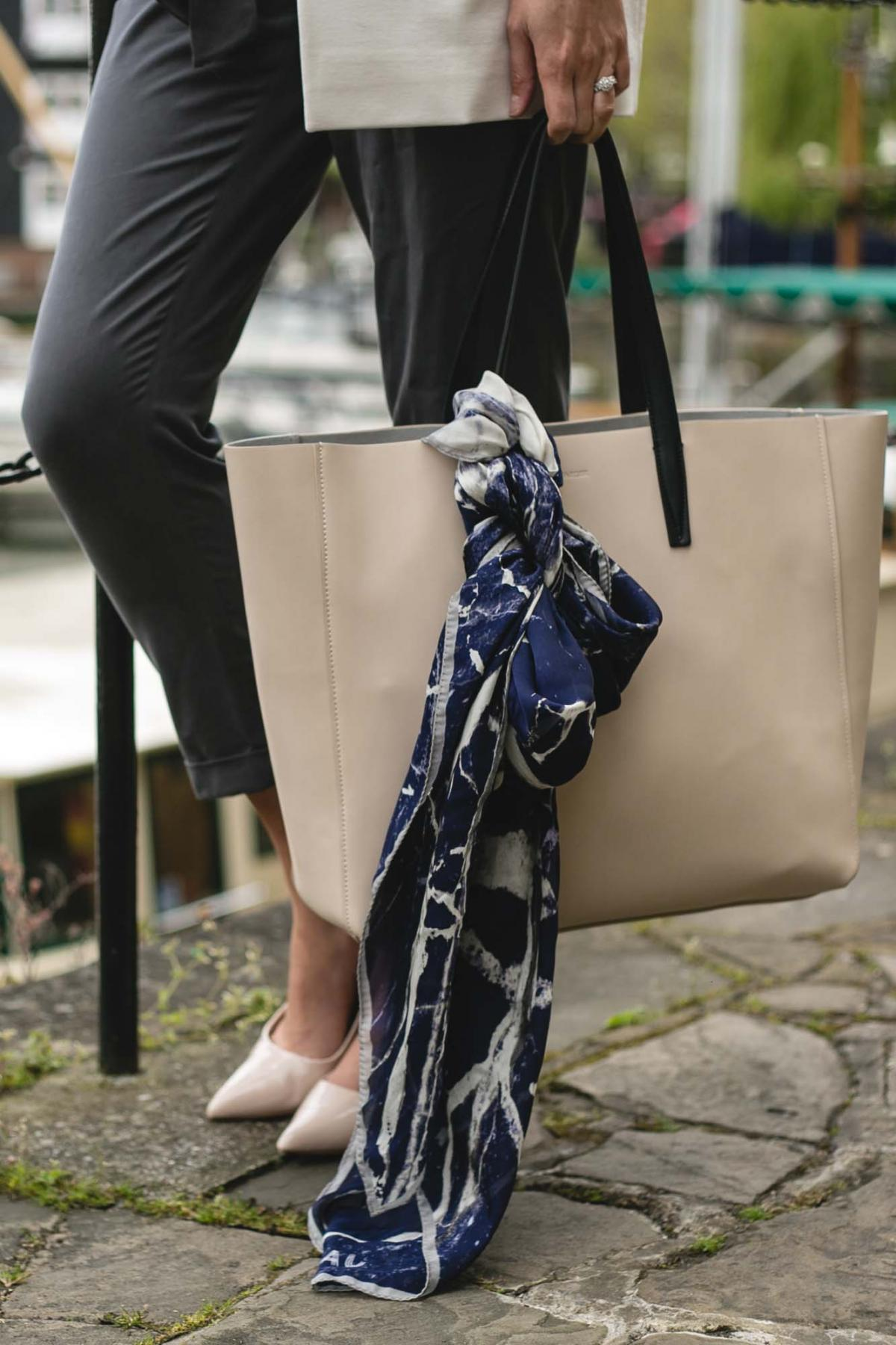 Jaeger leather tote bag with silk scarf, grey peg leg trousers