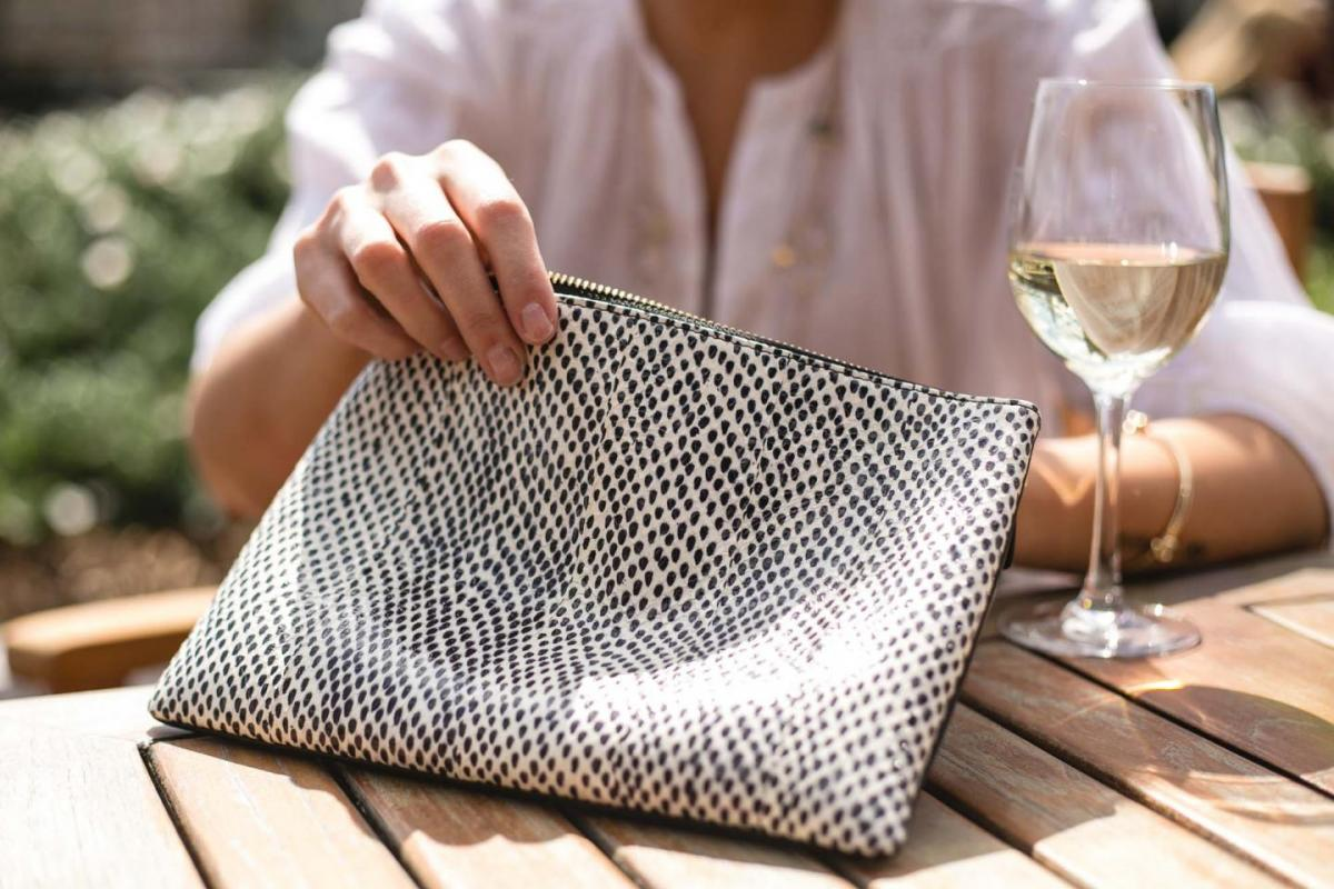 Jaeger white linen shirt, snakeskin effect leather pouch clutch bag