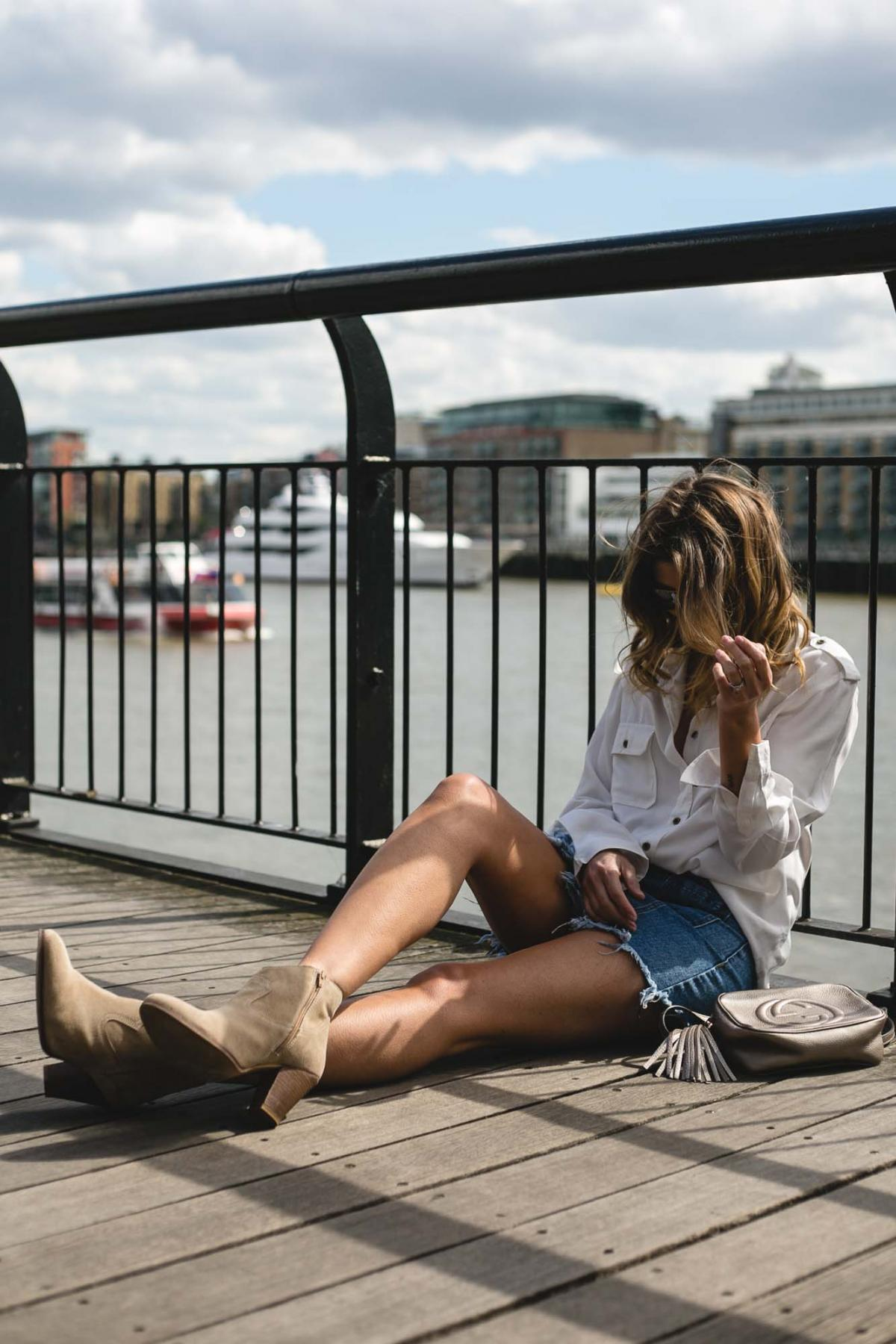 frayed denim skirt, gucci soho disco, white military shirt, summer outfit, beige suede western boots