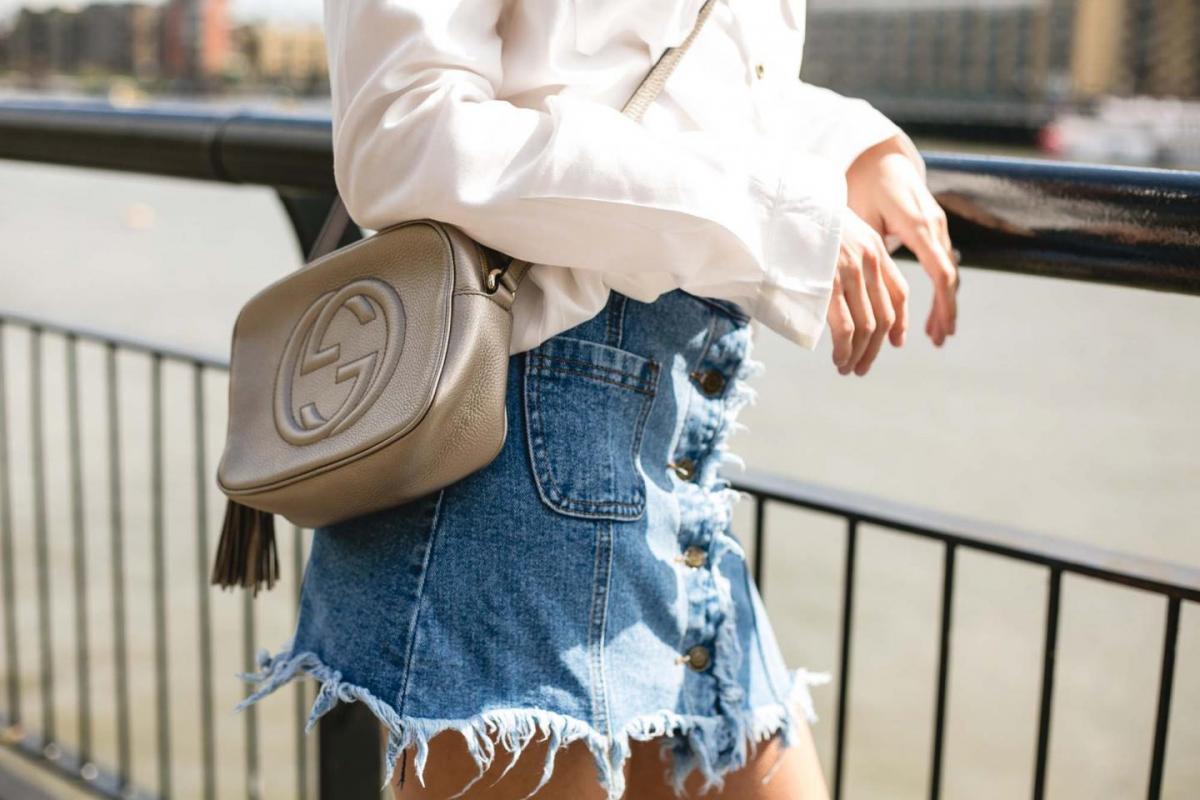 frayed denim skirt, white shirt, metallic gucci disco bag