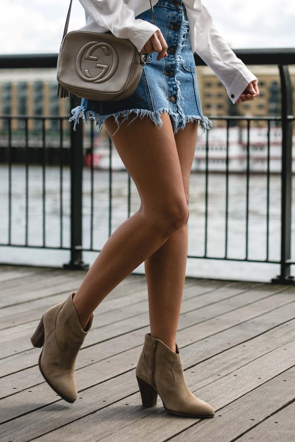 metallic gucci disco soho bag, frayed denim skirt, beige suede western ankle boots