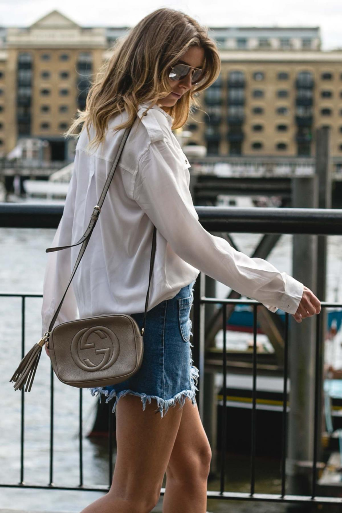 metallic gucci disco soho bag, frayed denim skirt, white military shirt