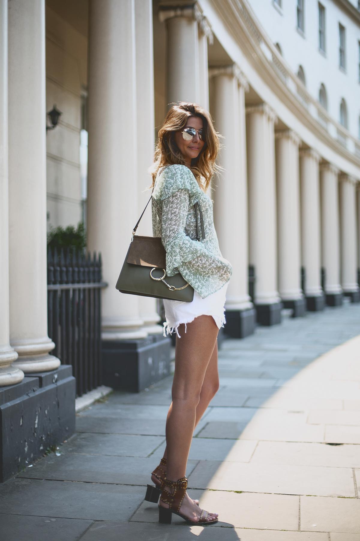 Green floaty top, white ripped denim shorts, khaki chloe faye bag, tan isabel marant sandals