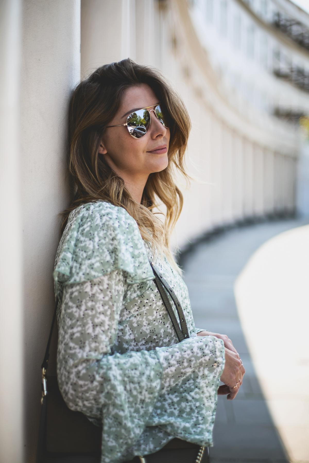 Green floaty top, khaki chloe faye bag, aviator sunglasses