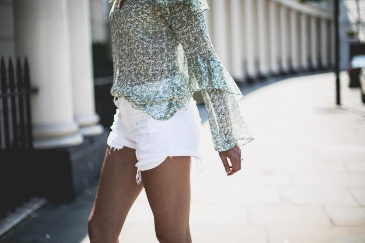 Gren floaty top with flare sleeves, white ripped denim shorts