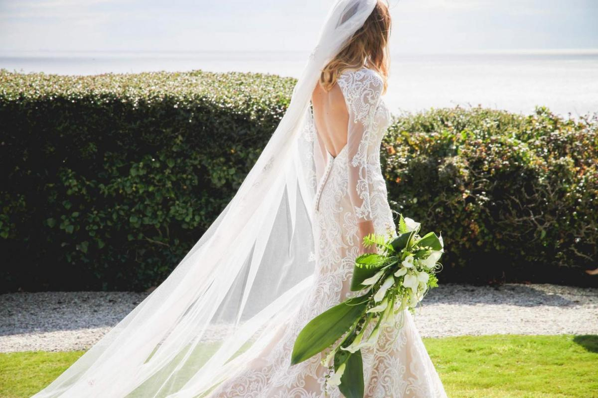 bride, cathedral veil, lace long sleeve backless wedding dress, calla lily bouquet