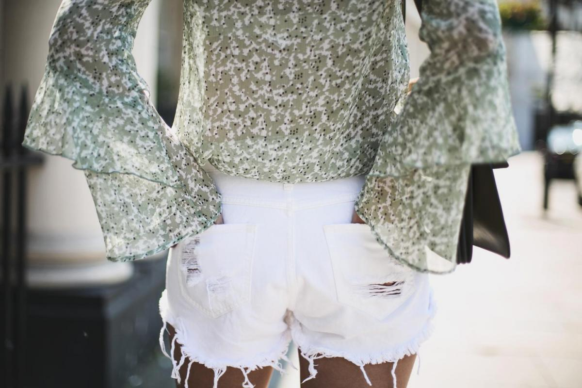 green chiffon floaty top, belle sleeves, boho, ripped white denim shorts