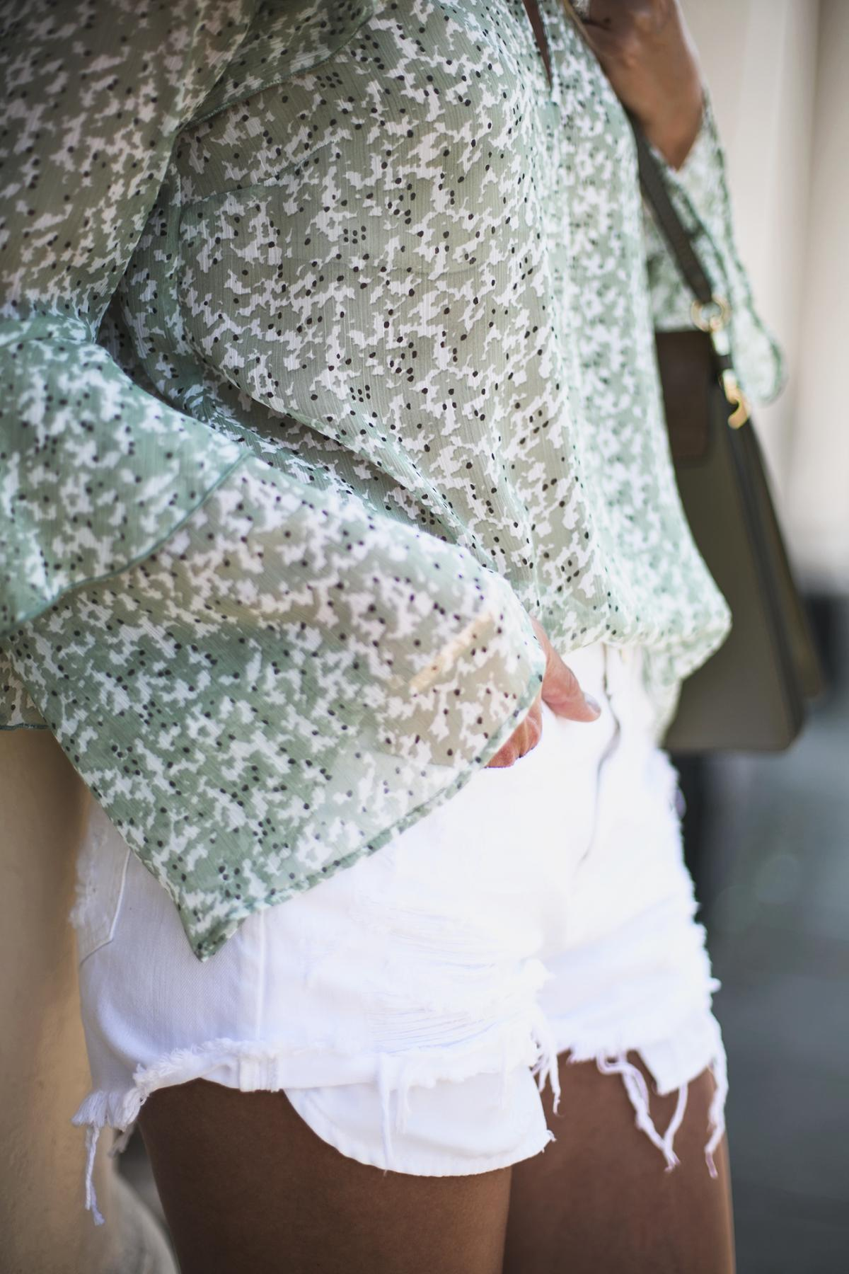 green chiffon floaty top, ripped white denim shorts