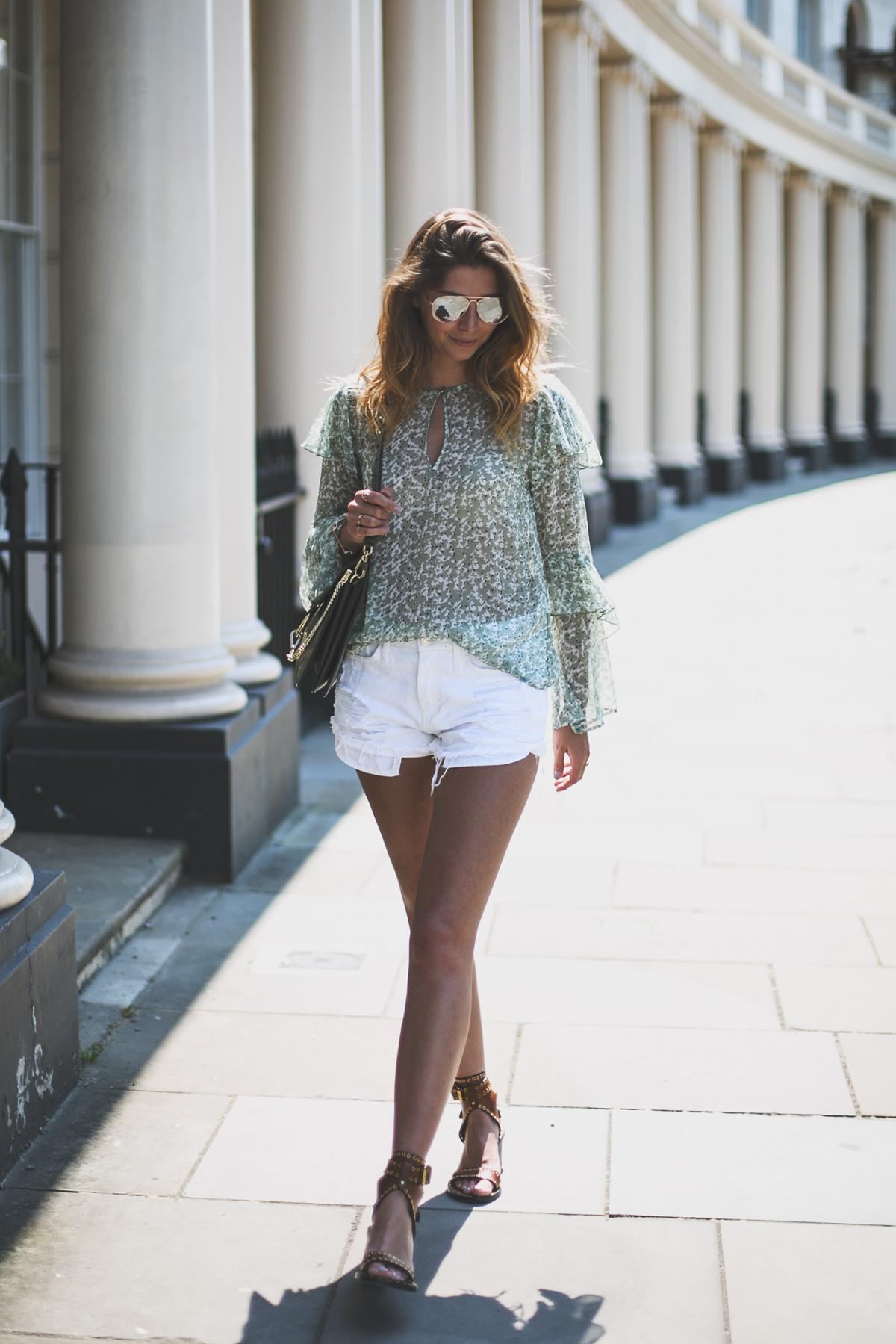 green printed floaty top with flare sleeves, white distressed denim shorts, khaki chloe faye bag, isabel marant tan leather sandals