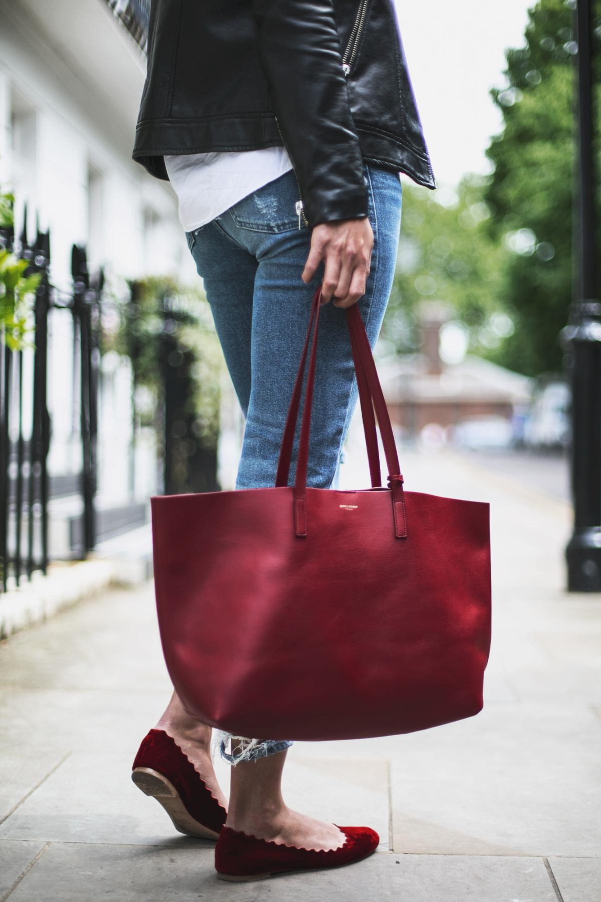 red suede chloe flats, skinny jeans, red saint laurent tote bag, biker jacket
