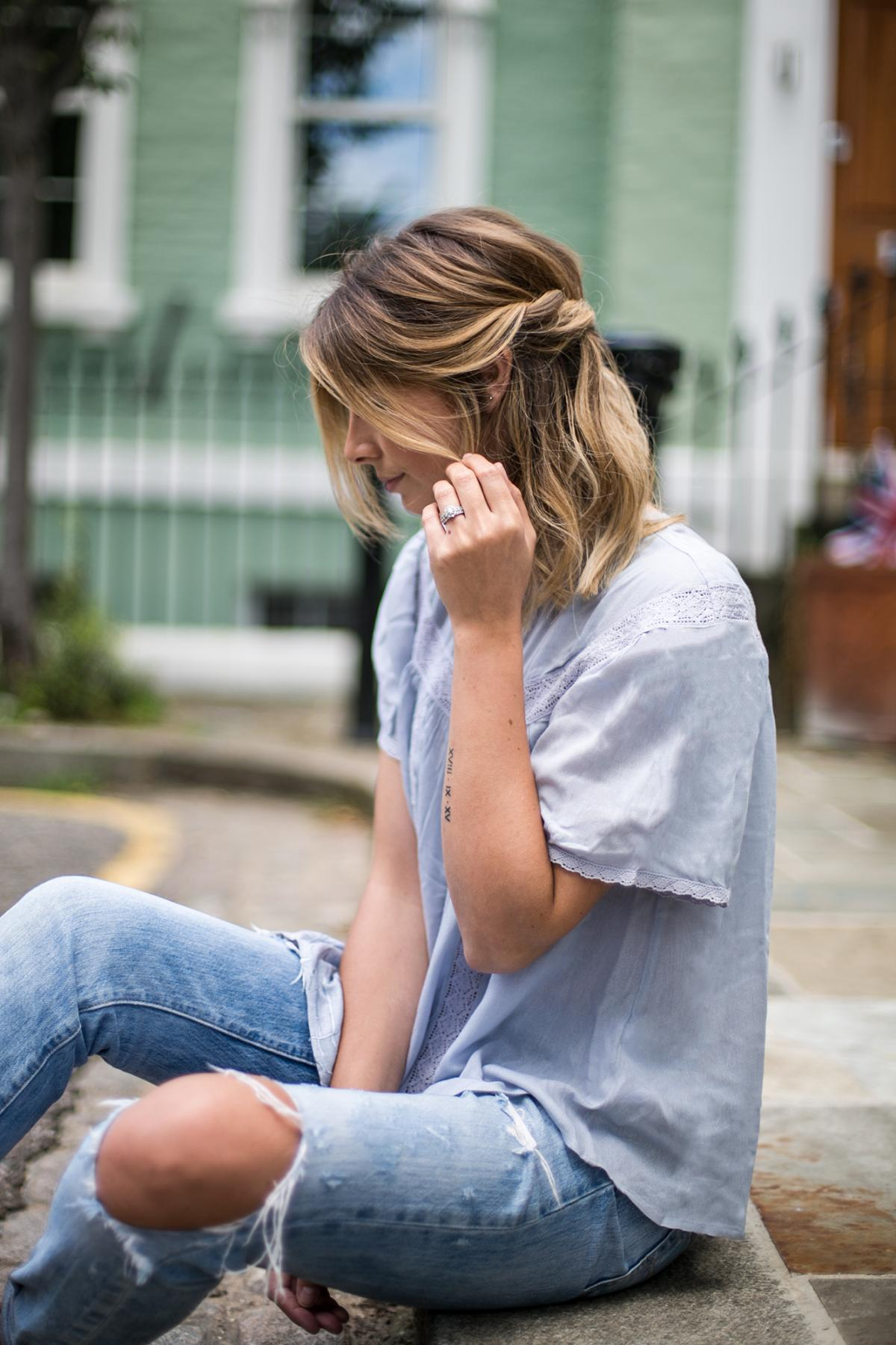 summer twist hair style, long bob, lob, blonde balayage hair, shoulder length hair style, ripped jeans, pale blue boho top