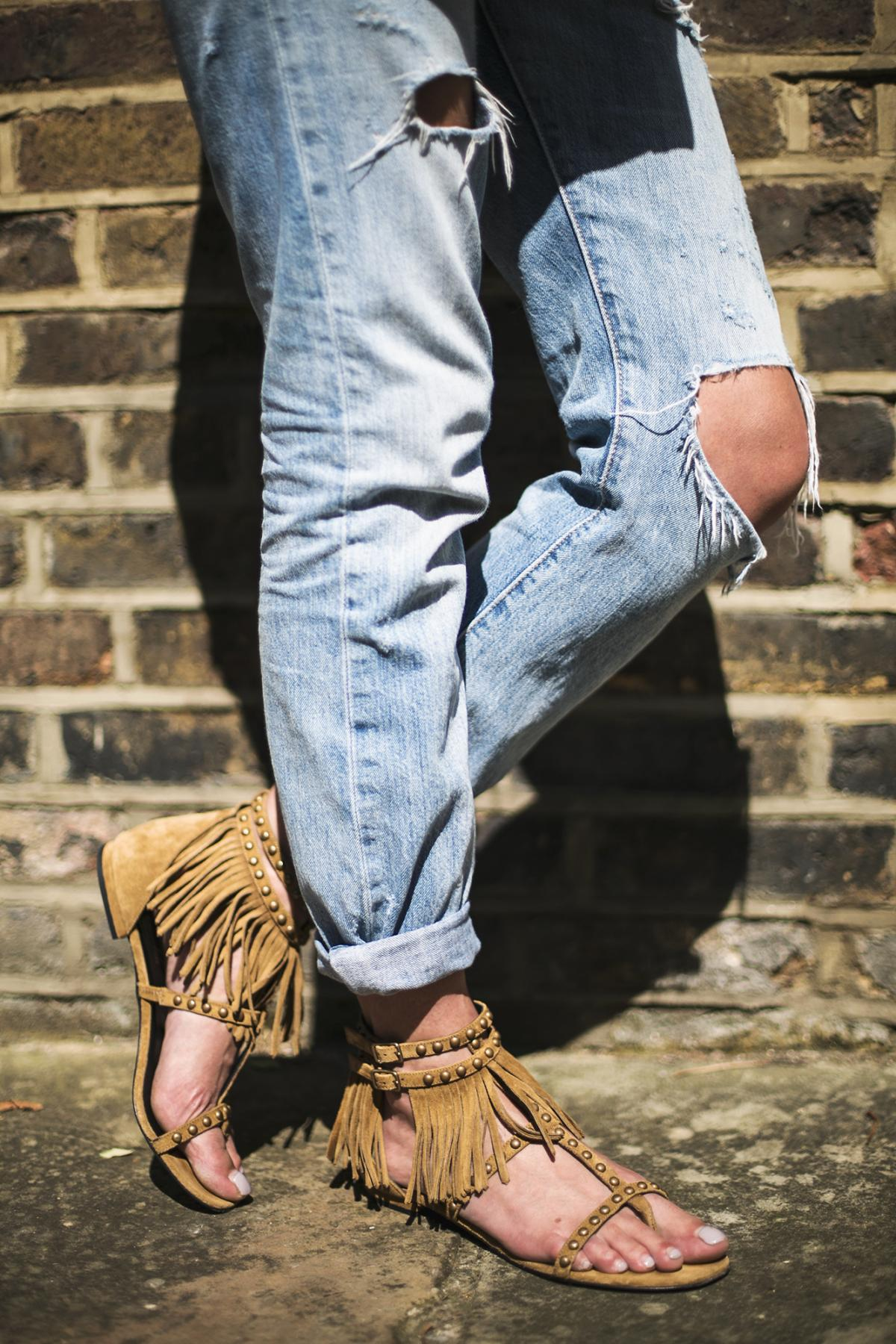 tan suede fringe saint laurent sandals, ripped boyfriend jeans