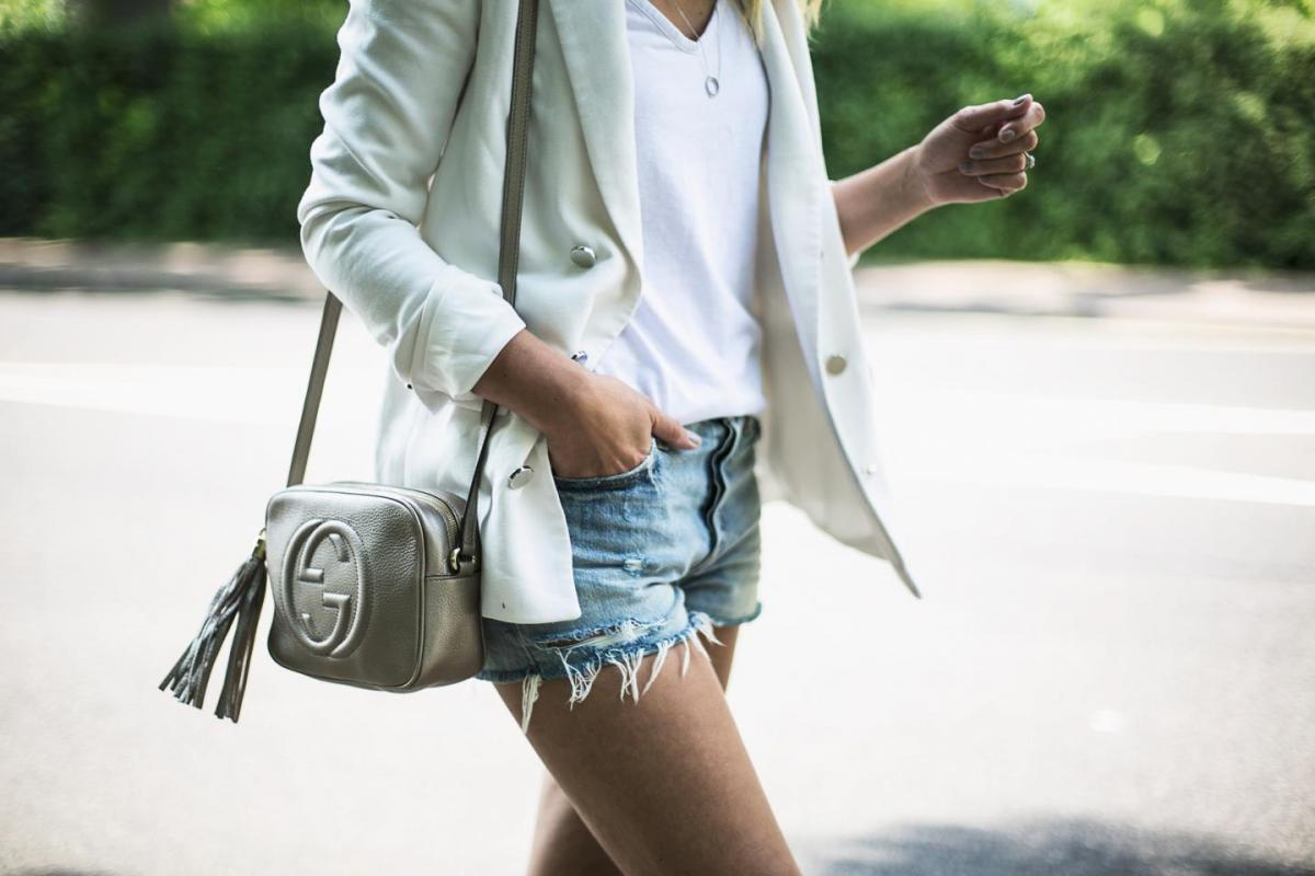 white blazer, white t shirt, levis ripped frayed denim shorts, metallic leather gucci soho disco bag