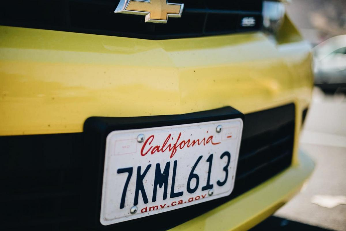 California license plate, yellow camera car
