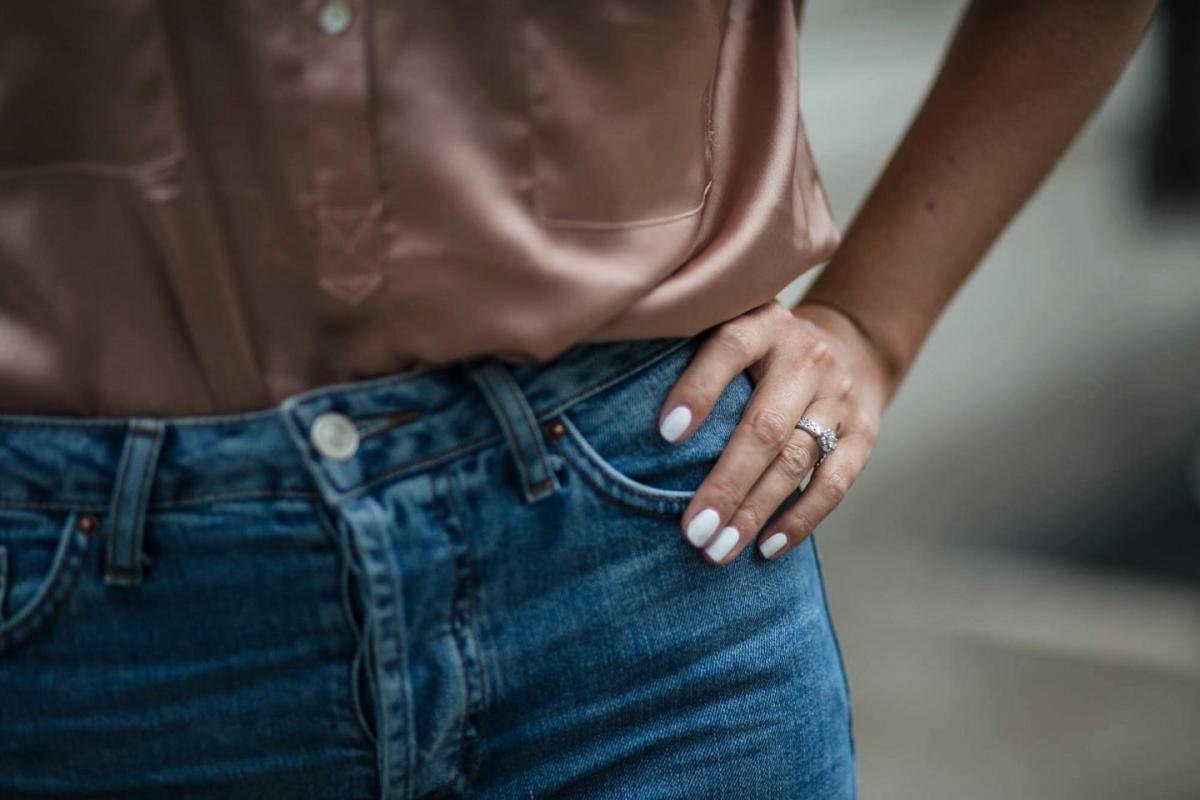 satin shirt, light wash denim, white nails manicure