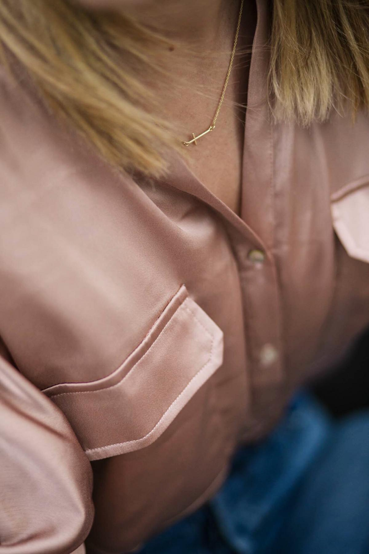 satin shirt, delicate gold cross necklace, dainty jewellery