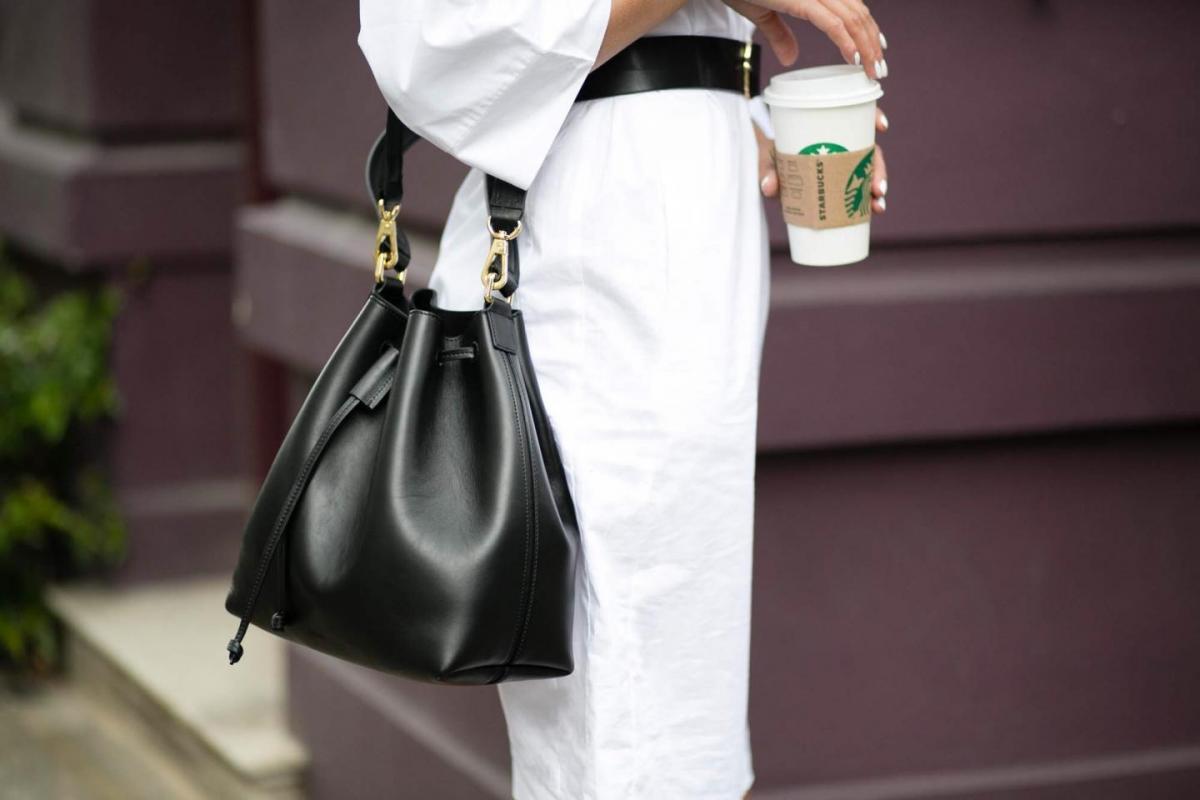 white shirt dress, black belt, black leather duffle bag