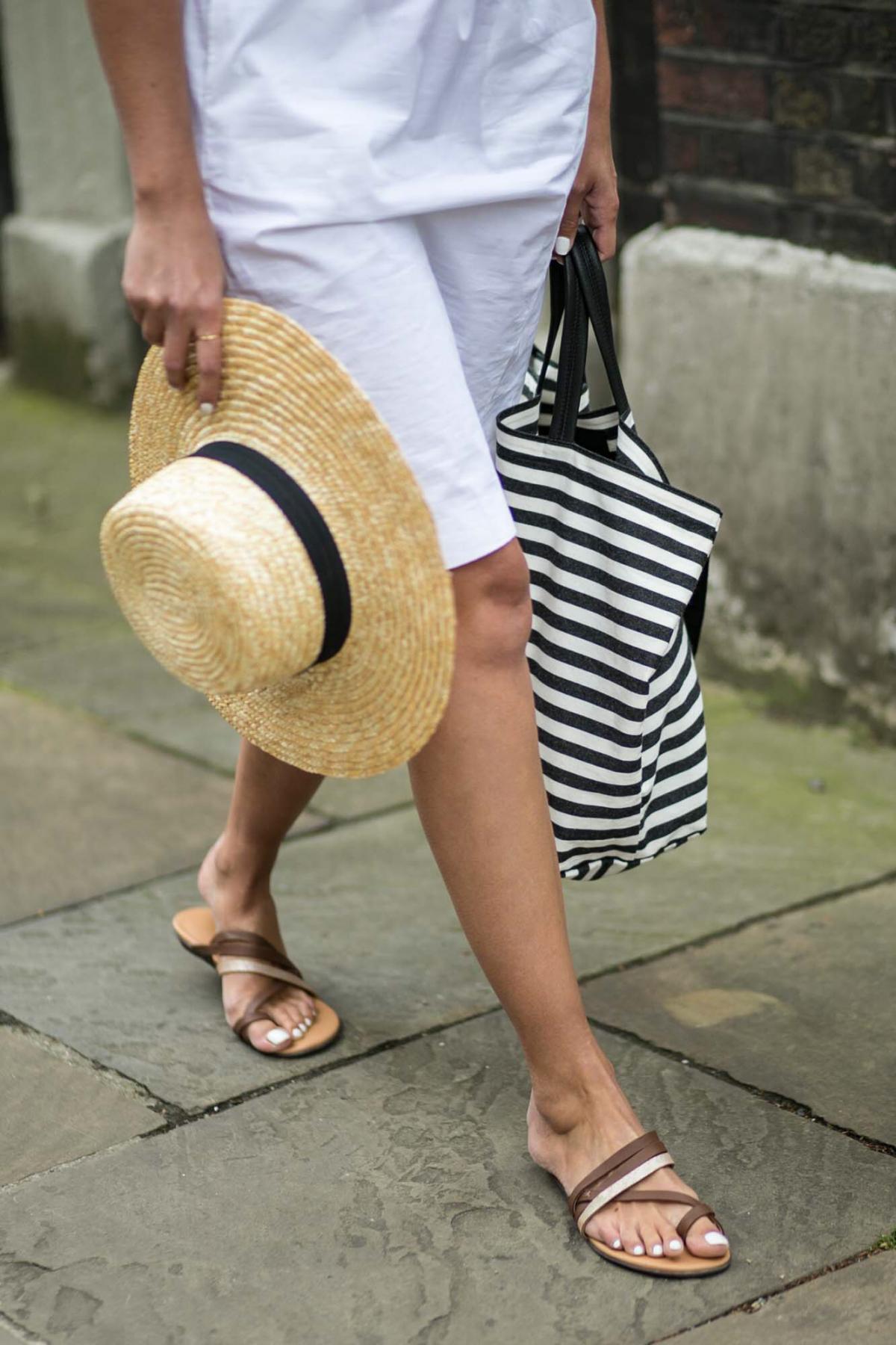 white shirt dress, woven boater hat, canvas stipe bag, tan gold sandals